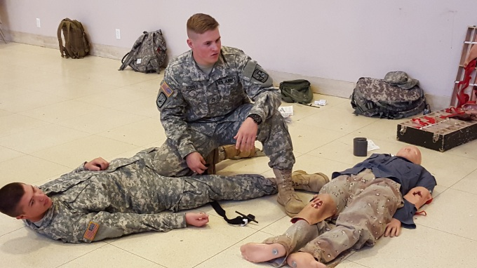 CDT Borgus demonstrates the use of a tourniquet on CDT Johnson during the First Aid lab.