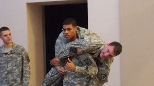 CDT Baez demonstrates the fireman's carry with CDT Clancy.